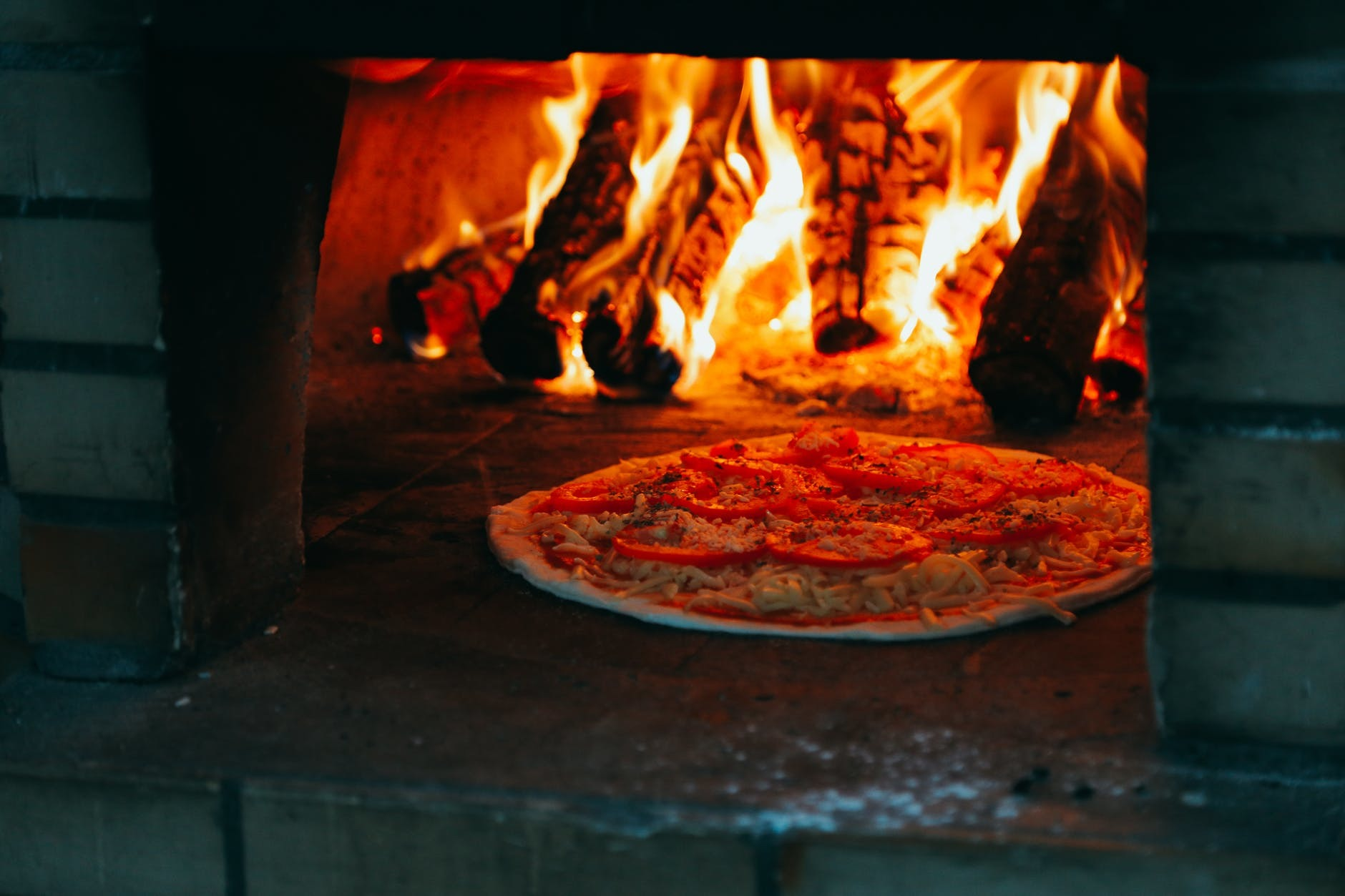 Cooked pizza in a ceramic oven